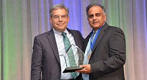 photo of ARC CEO Norman Chenven, MD receiving award